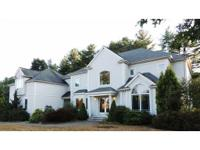 Beauty, style and comfort define this stucco Colonial