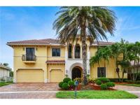 Beautiful 5 bedroom/5.5 bath courtyard home in gated