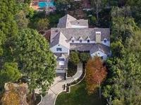 An ultra private, gated Traditional tennis court Estate