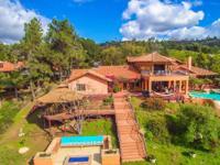 $1,190,000 -$1,230,000. Custom mediterranean estate in