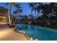 Located on a private cul-de-sac in the sought-after