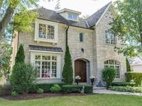 The stellar location of this classic stone and stucco,