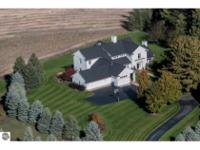 Situated high atop a ridge on 5 acres of land on Old