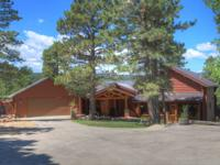 Nestled in pine-clad foothills of Spearfish this custom