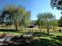 Country estate situated on over 27 acres! 7,000 sq ft