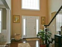 STATELY 5 BR, 5.5 BA COL ON PREMIUM ACRE LOT BACKING TO