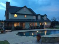 Impeccable 3 level traditional custom home situated on
