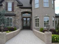 Stunning home at the entrance of Ridgepointe! This home