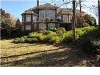 Handsome Greystone home behind the gates with