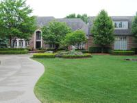 Fantastic curb appeal with almost 3 acres of beautiful