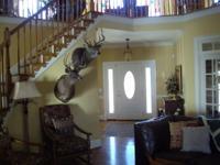 Here's a custom built home on 50+/- acs (additional