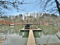 AMAZING custom lake home on over 1 acre! Not one detail