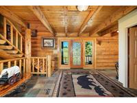 Extraordinary log home on 10 acres just minutes to