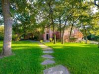 Beautiful home on gorgeous landscaped 1+ acre lot