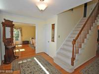 SPACIOUS AND OPEN! 5 BR, 3.5 BA. Hdw on Main Level.