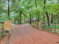 SPECTACULAR LOG WATERFRONT on 2.78 Treed Acres. Gated