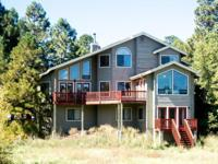 SPECTACULAR custom home overlooking the 14th, 15th, and