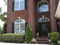 This 2 story 5 bedroom 3.5 bath brick home is located