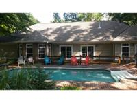 7026 Sq. Ft. home with Lake Views, 2 detached garages,