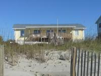 Come see this classic Emerald Isle ocean front gem! In