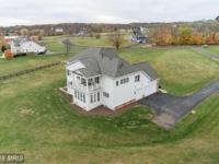 Sure to impress! Almost 6500sf on 3 finished levels, on