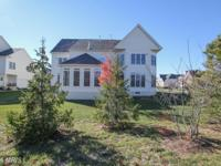 Brick front colonial. Well maintained. Over 6300 sq.
