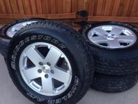 5 Bridgestone Dueler tires and wheels.  Were on a