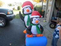 5 foot inflatable Penguins on a sled with tie downs 20