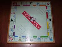 Solid wood box that contains 5 games, Monopoly, Chess,