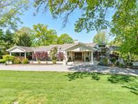 A casual, chic walkout ranch beautifully situated on