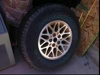 4 rims and tires from a 1994 Jeep Grand Cherokee in