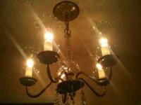5 light glass chandelier. Center is curved - spiral