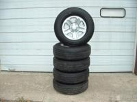 I HAVE 5 NEW RIMS & GOODYEAR WRANGLER ST TIRES SIZE