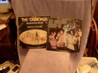 I HAVE 5 OSMOND RECORD ALBUMS. THEY ARE IN GOOD USED