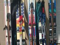 5 pairs downhill ski's 4 pairs poles and 2 storage bags