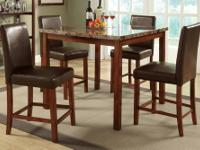 BRAND NEW METAL DINIG SET INCLUDES TABLE AND 4 CHAIRS.