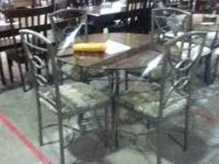 PRE OWNED GLASS TABLE TOP METAL FRAME AND CHAIRS.