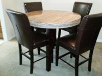 I purchased this 5-piece dining room set from Marlo