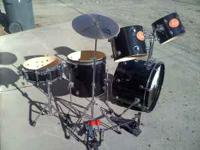 "5 piece Pearl drum set -- Black W/ ""Pearl"" decals."