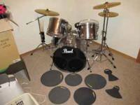 "5 piece pearl drum set, comes with 20"" ride cymbal, 14"""