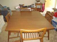 For sale is a 5 piece solid wood dining room table with