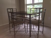 This dining set (color: Espresso) from Walmart is just