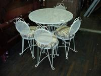 5 piece wrought iron patio set made in the 1960's in