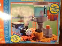 Listed are five Thomas the Train sets: Water Tower