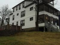 Three story w/5 apartments - 2 studios,. 2- 1BR's & 1-