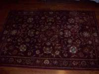 I am selling a 5' x 7' burgundy floral rug. It is in