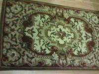 Very lovely Rug about 5' long by 3' wide. Kept in good