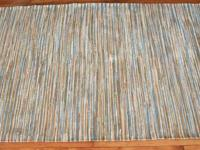 "High end brand-new cotton woven rug. Size: 5'x8'3""."