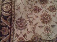 -The first item is a 5'x8' area rug. No stains or spots