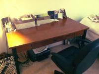 This is an AMAZING desk. It's a vintage/antique and